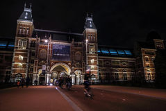 Moving silhouettes of cyclists and passersby near Rijksmuseum. Stock Image