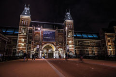 Moving silhouettes of cyclists and passersby near Rijksmuseum. Royalty Free Stock Photography