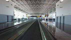 Interior of modern airport. Moving slowly on travelator, interior of modern airport stock video footage