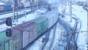 Moving small freight train on railway at winter. Day stock video