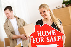 Moving: Smiling Woman Holds For Sale Sign Royalty Free Stock Photography