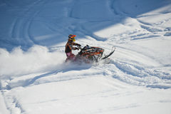 Moving snowmobile in winter forest in the mountains. SAKHALIN RUSSIAN - JANUARY 23 : Oleg Bibikov moving snowmobile in winter forest in the mountains of Sakhalin Royalty Free Stock Photos