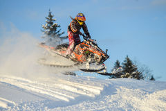Moving snowmobile in winter forest in the mountains. SAKHALIN RUSSIAN - JANUARY 23 : Oleg Bibikov moving snowmobile in winter forest in the mountains of Sakhalin Stock Photography