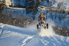 Moving snowmobile in winter forest in the mountains Royalty Free Stock Images