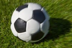 Moving soccer ball Stock Photos