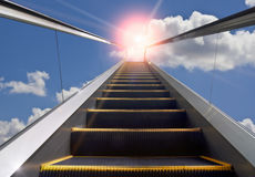 Moving staircase and blue sky. Express everything, ascendant Stock Image