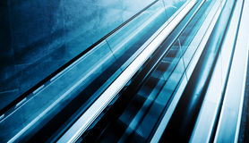 Moving staircase escalator as modern background Royalty Free Stock Images