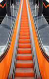 Moving staircase. Orange moving staircase going up Stock Photography