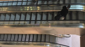 Moving staircase with people running up and down. Modern escalator stairs, which moves indoor. Escalators run upstairs and downsta. Irs. People climb up the stock video footage