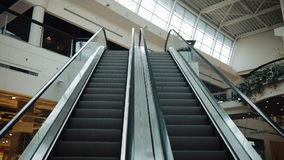 Moving staircases go up and down in the shopping mall.  stock video