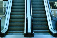 Moving stairs in store. Escalator stock photos