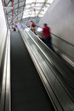 Moving stairway with people Royalty Free Stock Image