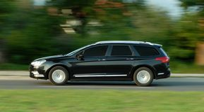 Moving station wagon Royalty Free Stock Images