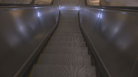 Moving the steps to the escalator down. An empty shopping center, there are no people stock footage