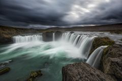 Long exposure of dark clouds over Godafoss Waterfall in Icealnd Royalty Free Stock Photo