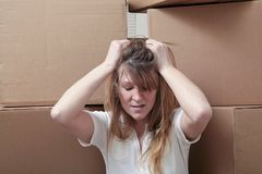 Moving stress. Caucasian woman overwhelmed by the stress of moving Stock Photography