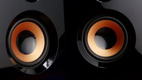 Moving sub-woofer. Speaker cone pumping. Closeup stock video footage