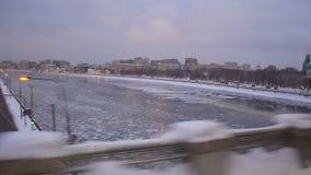 Train city winter window. Moving subway train city landscape stock video