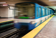 Moving subway train with an empty subway platform. Royalty Free Stock Photo