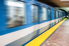 Moving subway train and Motion blur with an empty subway platfor Stock Photos