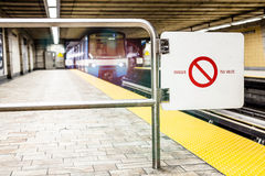 Moving subway train and Motion blur with Safety Interdiction Sig Royalty Free Stock Photography