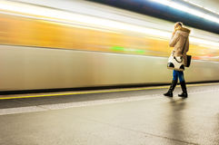 Moving subway train and passenger at Karlsplatz station, Vienna, Austria. Royalty Free Stock Photos