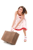 Moving a suitcase Royalty Free Stock Photography