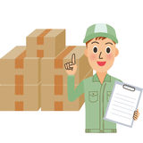 Moving supplier. The moving supplier who counts a cardboard box Royalty Free Stock Image