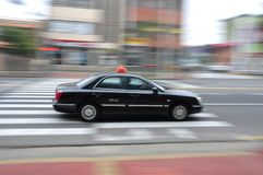 Moving taxi Stock Images