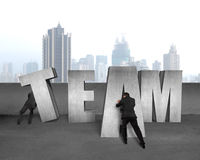 Moving TEAM concrete word together Stock Photos