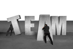 Moving TEAM 3D concrete word together Royalty Free Stock Photography