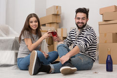 Moving in, time for joy, young couple celebrating relocation. Stock Photos