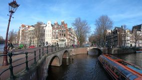 Moving Timelapse of Canal tour boats in Amsterdam going under bridges