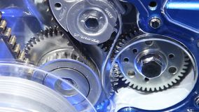 Moving timing belt gears stock video