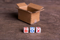 Moving to another office or house. Word box. On an old wooden background Stock Image