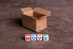 Moving to another office or house. Word move. On an old wooden background Royalty Free Stock Photography