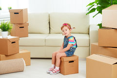 Moving to new apartment. happy child and cardboard box Royalty Free Stock Image