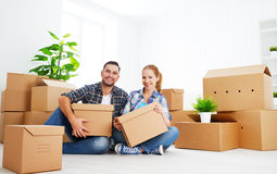 Moving to a new apartment. Happy family couple and cardboard box. Moving to a new apartment. Happy family couple and a lot of cardboard boxes Royalty Free Stock Photography
