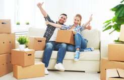 Moving to a new apartment. Happy family couple and cardboard box Stock Photo