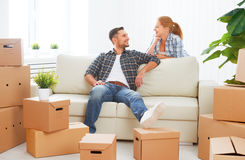Moving to a new apartment. Happy family couple and cardboard box. Moving to a new apartment. Happy family couple and a lot of cardboard boxes royalty free stock photo