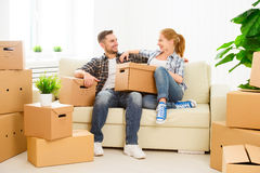 Moving to a new apartment. Happy family couple and cardboard box Royalty Free Stock Photos