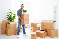 Moving to a new apartment. happy man with cardboard boxes Stock Photography