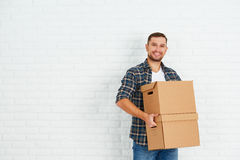 Moving to a new apartment. happy man with cardboard boxes Royalty Free Stock Images