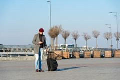 Moving to new city alone. Man bearded hipster travel with luggage bag on wheels. Traveler with suitcase arrive airport. Railway station urban background royalty free stock image