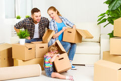 Moving to new home. Happy family with cardboard boxes Royalty Free Stock Photography