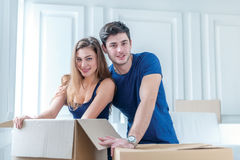 Moving to a new house and repairs in the apartment. Love couple Stock Images