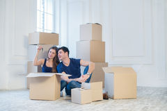 Moving to a new house and repairs in the apartment. Love couple Stock Photos