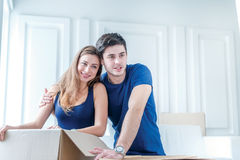 Moving to a new life. A girl and a guy holding boxes for moving Stock Photography