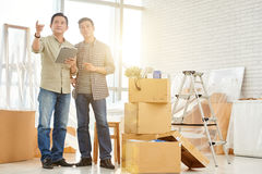 Moving to office. Vietnamese business people moving to new office royalty free stock photo