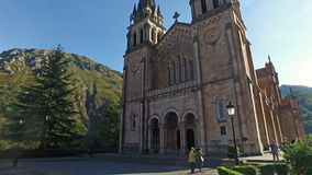 Moving towards the impressive Basilica of Covadonga 04 stock footage